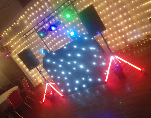 Beano Disco DJ set up with red white blue and green lighting