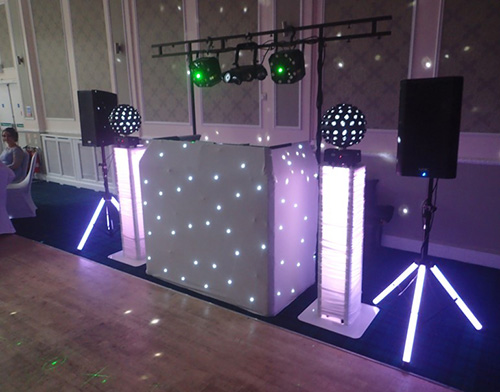 Beano Disco set up for a wedding with white and green lights