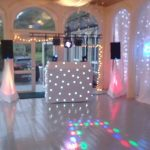 Beano Disco set up for a wedding with starlights and white backdrop